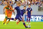 <b>Spot Finish</b> Japan's Keisuke Honda takes a penalty against Ghana