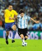 Messi vies for the ball with Brazil's Gilberto Silva