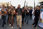 Iraqi Shiite tribal fighters chant slogans against the al-Qaeda inspired Islamic State of Iraq and the Levant