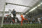 England's Wayne Rooney heads the ball at the crossbar during the group D World Cup match between Uruguay and England.