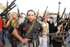 <b>Counter Attack</b> Shia militiamen chant anti-ISIS slogans in Baghdad on June 13