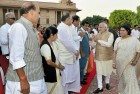 <b>More Of The Same, Please</b> PM Narendra Modi with members of his new cabinet at the swearing-in on May 19, Delhi