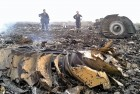 Emergency workers at the crash site of the Malaysian Airline Boeing 777 at Grabovo in Ukraine's Donetsk region