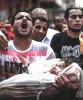 <B>Is it worth it?</b> Palestinian relatives carry the body of a child killed in an Israeli strike