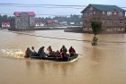 <b>Srinagar</b> A huge relief op is under way; an army team rafts a group to safe, dry ground