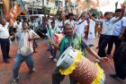 BJP activists dance in-front of their party office to celebrate their victory in Basirhat Dakshin Constituency in State Assembly by-election in Kolkata