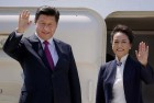 Chinese President XI Jinping with wife Peng Liyuan waves before their departure at Air Force station Palam in New Delhi.