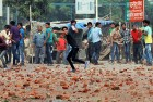 Mobs pelt stones during the riots, Oct 25