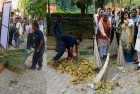 TV Grab Combo: Garbage being dumped on a Delhi side walk, allegedly some time before the BJP's state unit chief Satish Upadhyay took a broom to it as part of the Swachh Bharat Abhiyan mission, in New Delhi, on Wednesday 5th November, 2014. Shazia Ilmi, who recently walked out of the Aam Aadmi Party, was also present for the cleanliness drive.