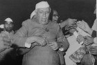 Braced for the worst Nehru is prevented from plunging into a riotous crowd in 1962, before the war