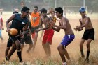 <B>Dust and grime</b> A footy game in progress at Shivaji Park maidan in Mumbai