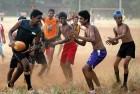 <B>Dust and grime</b> A footy game in progress at Shivaji Park maidan in Mumbai