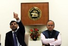 <b>Cut rate</b> Finance minister Arun Jaitley, right, with RBI governor Raghuram Rajan at the bank's central board meeting in Delhi