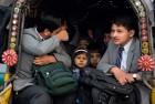 Pakistani children near Army Public School in Peshawar where Taliban terrorists killed 150 of their classmates and teachers