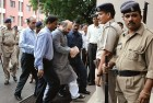 <b>Charge, no charge</b> Shah with CBI officials
