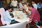 <b>Design point</b> KCR discusses a temple design with officials