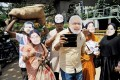 <b>New masks?</b> A Congress protest over corruption in the BJP, Bangalore, Jul 5