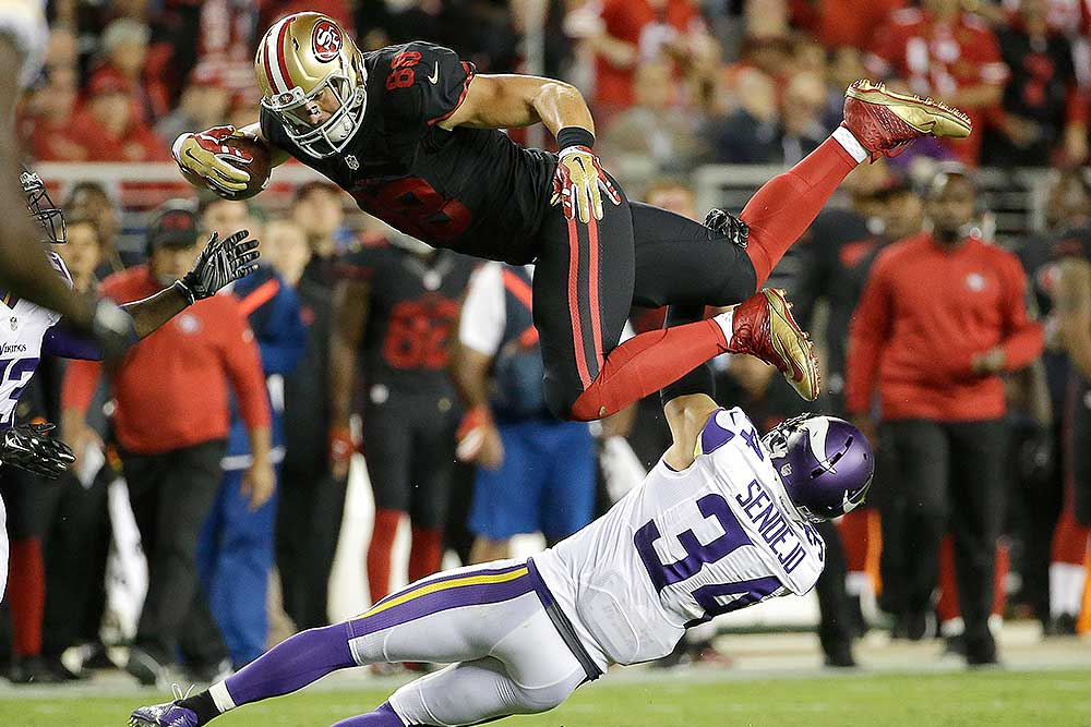 bd8374ed7a3 San Francisco 49ers tight end Garrett Celek (88) is tackled by Minnesota  Vikings strong safety Andrew Sendejo (34) during the first half of an NFL  football ...