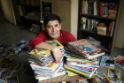 The author with his ever-growing piles