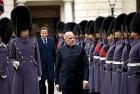 <b>Scots On Guard</b> PM Modi inspects a guard of honour in London
