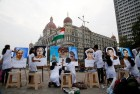 Art school students paints portraits of policemen martyrs of the Nov. 26, 2008 Mumbai terror attacks, outside the Taj Mahal Hotel, one of the sites of the attack, in Mumbai