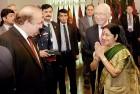 <b>Howdy</b> India's foreign minister Sushma Swaraj meets Pak PM Nawaz Sharif as foreign affairs advisor Sartaj Aziz looks on