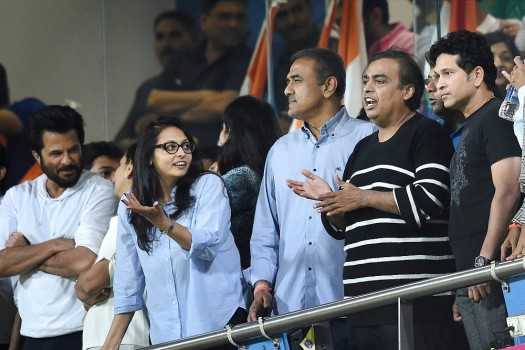 Actor Anil Kapoor, NCP leader Praful Patel, Industrialist Mukesh Ambani and cricket legend Sachin Tendulkar watching the ICC WT20 Semi Final match between India and West Indies at Wankhede Stadium in