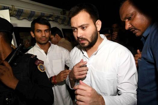 Bihar's Depoty CM Tejaswi Yadav with Health Minister Tej Partap Yadav after Bihar CM Nitish Kumar resigned, in Patna.