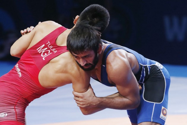 Outlook India Photo Gallery - Bajrang Punia Wins Bronze Medal At World Wrestling Championships, Ravi Dahiya Adds To India's Tally