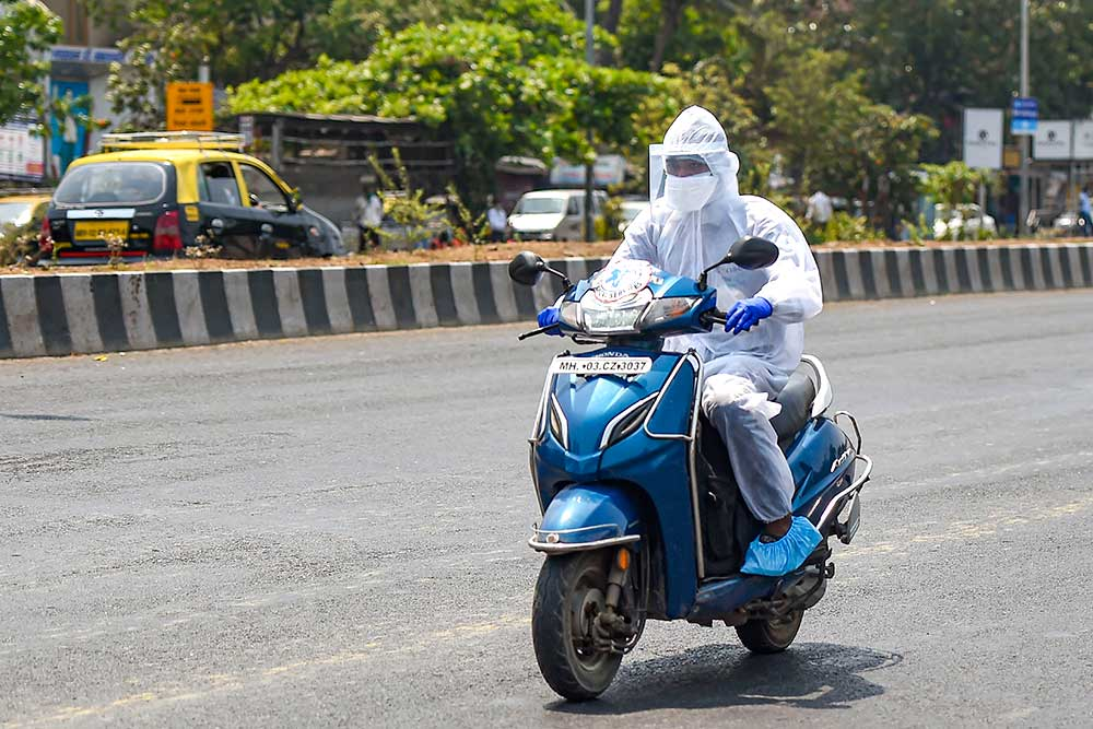 Outlook India Photo Gallery - Hazmat Suits / Personal Protective Equipment  (PPE) suit