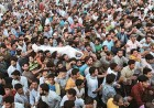 Defiant: Curfew didn't keep thousands from the funeral of separatist leader Abdul Aziz Sheikh