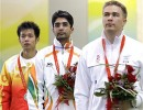 Gold medalist Abhinav Bindra, center, with silver medalist Zhu Qinan, left, of China, and bronze medalist Henri Hakkinen, of Finland during the medal ceremony