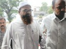 Caught: Suspect Abdul Halim is brought to court in Ahmedabad