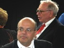 To his left, the right hand man: Warren Buffett and Ajit Jain