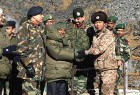 Puffed up: Minister A.K. Antony greets a Chinese soldier at Nathu La on Dec 2, '07