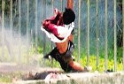 The body of one of the slain terrorists at Ayodhya is blown into the air...
