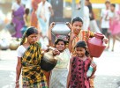 Uneasy flow: Women and children carry water in Bankura