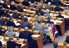 A member of parliament displays the Tibetan flag during a plenary session at the European Parliament in Brussels