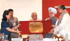 Sonia, Motilal Vora and Manmohan Singh present the Indira Gandhi Integration award to Prof Bandookwala (extreme right)