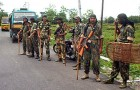CRPF personnel patrol at the Hill Cart road near Siliguri