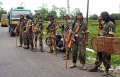 CRPF personnel patrol at the Hill Cart road near Siliguri
