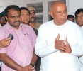 Weaving wishes: Deve Gowda with son H.D. Kumaraswamy