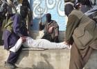 Flog power: Taliban men deal it out to an alleged drug dealer in Dheri, Swat valley, on Jan 11, '09
