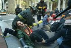Loretta Linseed of San Francisco, left, yells in pain as firefighters use a saw to cut apart anti-war protesters who linked themselves together with metal pipes in order to block Market Street in San Francisco's financial district, Thursday, March 20, 2003