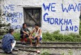 Darjeeling derailed : Villagers sit on railway tracks in the region during a strike called by the Gorkha Janamukti Morcha