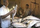Ilish being bought at a Calcutta market