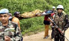 Costly charity: Indian peacekeepers carry a patient in war-torn Congo's Masisi, Nov 22, '07