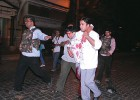 Day of infamy: Security personnel carry the injured out of the Taj hotel