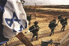 Israeli soldiers walk towards the northern Gaza Strip as seen from the Israeli border with Gaza