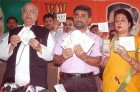 BJP leader Lalji Tandon, left, releasing the controversial pack of CDs